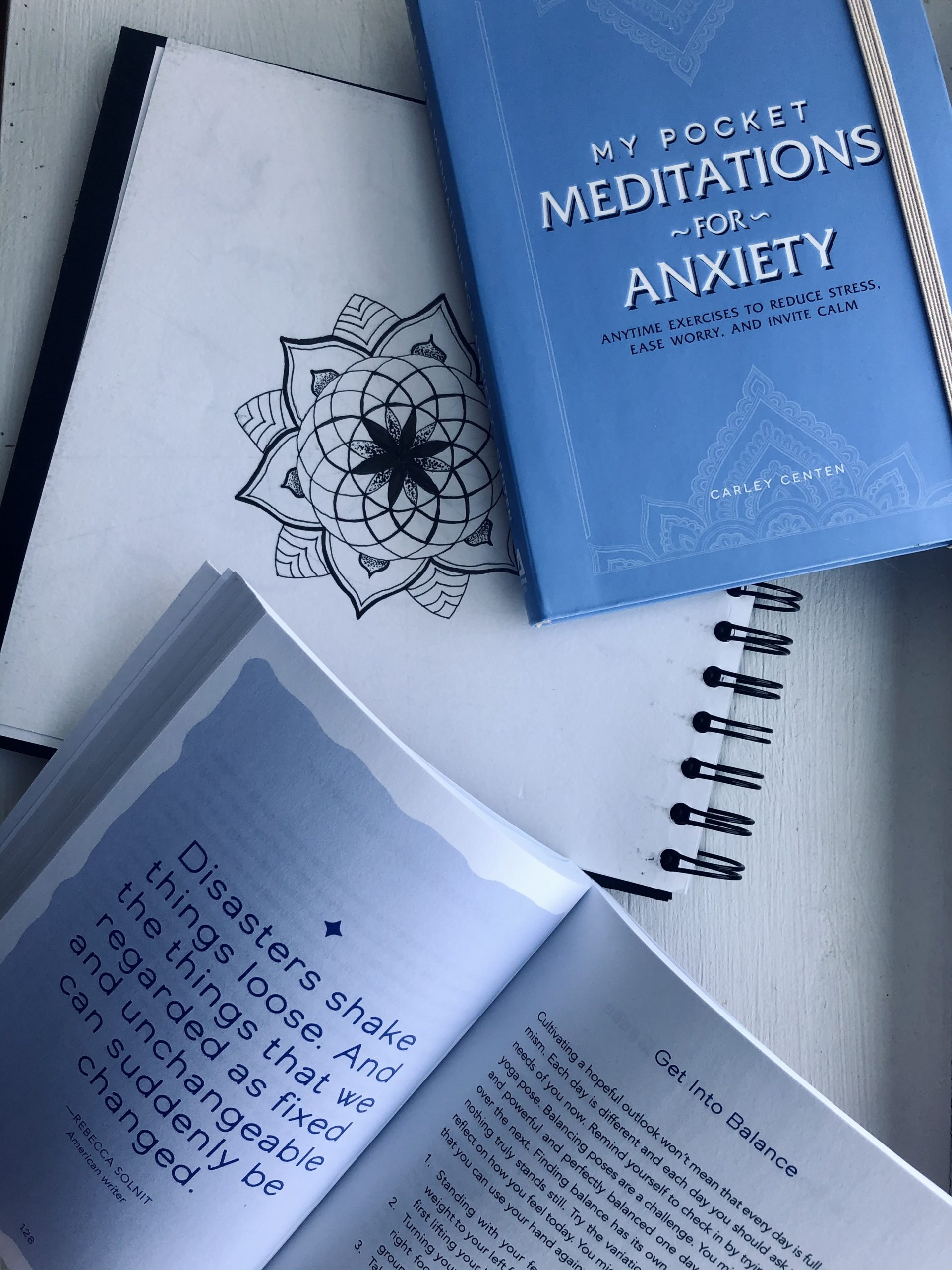 Open book of hope page with book of mediations and a sketchbook with mandala